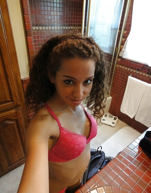 Curly Latina student kitten takes some intimate pics in the bathroom