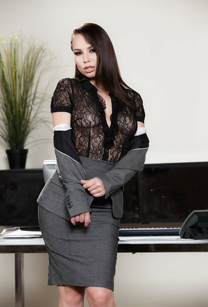 Flirtatious youthful woman works alone in the office and can strip during phone call