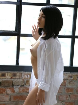 Photographer can't get quite enough of cute asiatic babe's boobs under shirt