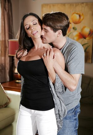 Latina Eager mom with big boobs puts a hand in young-looking lover's pants embarrassing him