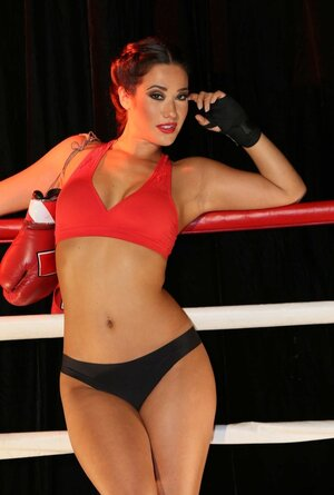 Super-hot babe with boxing gloves on neck knocks down with awesome ass