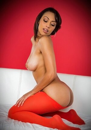 Beautiful Latina model displays unbelievable boobies and moreover pussy with hot lips