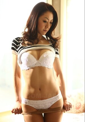 Oriental housewife pulls striped T-shirt up exposing white bra as lad grabs her tit