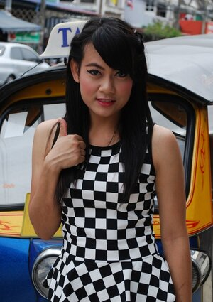 Inviting Thai porn model in a checkered dress gets into the Tuk Tuk Taxi