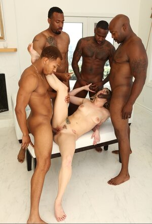 Hungry floozy dragged into interracial team fuck sex with four Ebony stallions